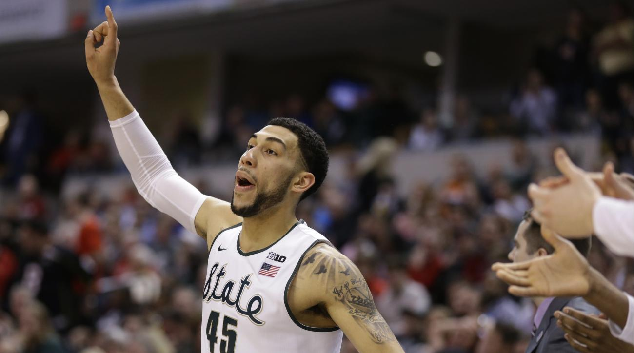 Michigan State's Denzel Valentine (45) reacts on the bench during the second half of an NCAA college basketball game against Ohio State in the quarterfinals at the Big Ten Conference tournament, Friday, March 11, 2016, in Indianapolis. AP Photo/Michael Co