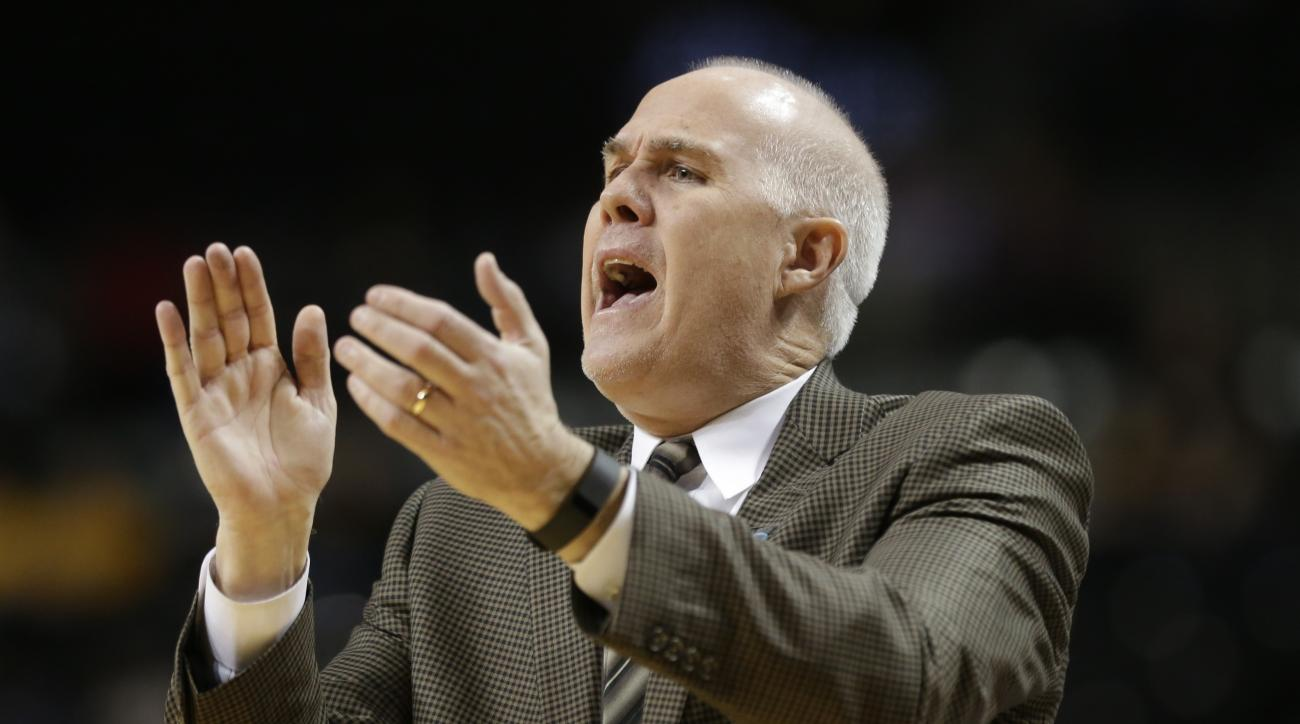 St. Bonaventure head coach Mark Schmidt calls out to his team during the first half of an NCAA college basketball game during the Atlantic 10 men's tournament against Davidson Friday, March 11, 2016, in New York. (AP Photo/Frank Franklin II)