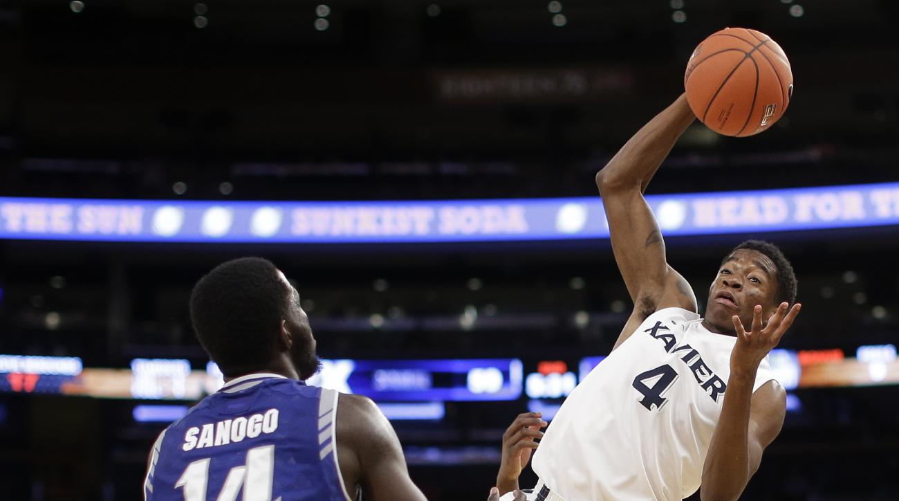 Xavier guard Edmond Sumner (4) pulls down an inbounds pass as he is guarded by Seton Hall guard Ismael Sanogo (14) durilng the second half of an NCAA college basketball game during the semifinals of the Big East men's tournament, Friday, March 11, 2016, i