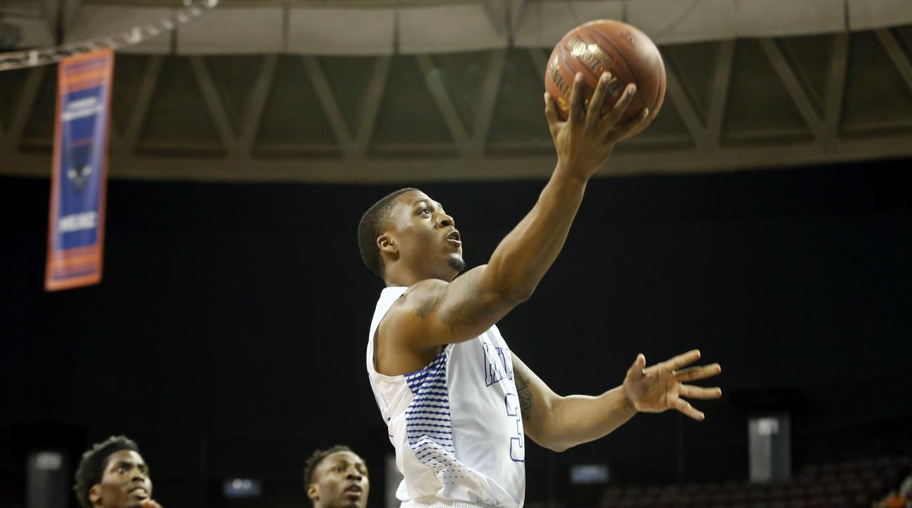 Hampton's Reginald Johnson Jr. goes to the basket during the first half of an NCAA college basketball game against South Carolina State in the championship of the Mid-Eastern Athletic Conference men's tournament in Norfolk, Va., Saturday, March 12, 2016.