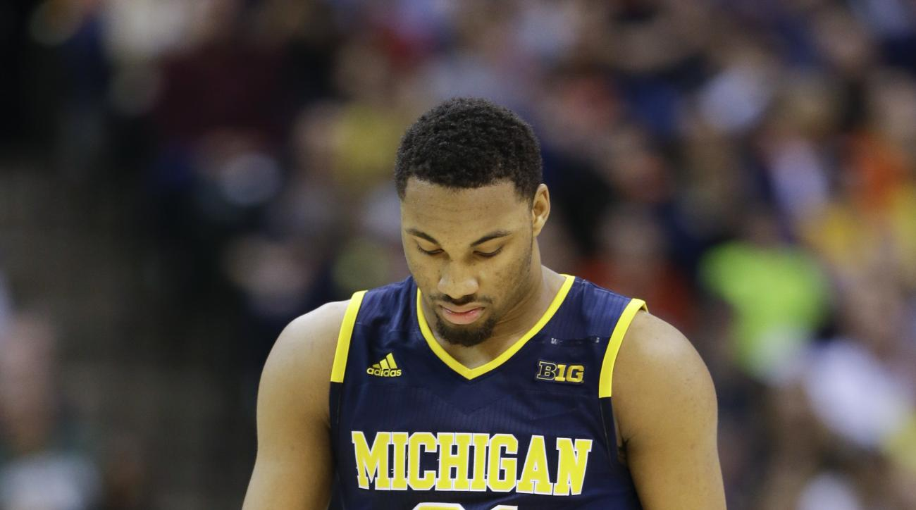 Michigan guard Zak Irvin (21) walks down the court in the second half of an NCAA college basketball game against Purdue during the semifinals of the Big Ten Conference tournament in Indianapolis, Saturday, March 12, 2016. Purdue defeated Michigan 76-59. (