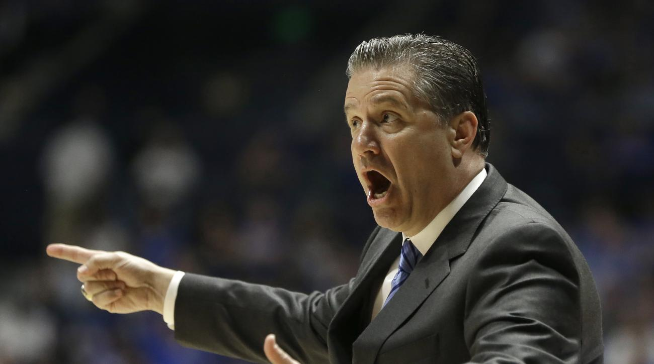 Kentucky head coach John Calipari directs his team against Georgia during the first half of an NCAA college basketball game in the Southeastern Conference tournament in Nashville, Tenn., Saturday, March 12, 2016. (AP Photo/Mark Humphrey)