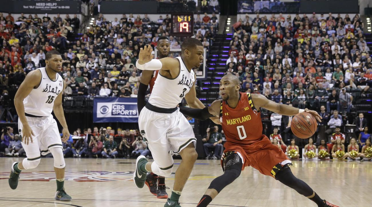 Maryland guard Rasheed Sulaimon (0) drives on Michigan State guard Alvin Ellis III (3) in the first half of an NCAA college basketball game during the semifinals of the Big Ten Conference tournament in Indianapolis, Saturday, March 12, 2016. (AP Photo/AJ