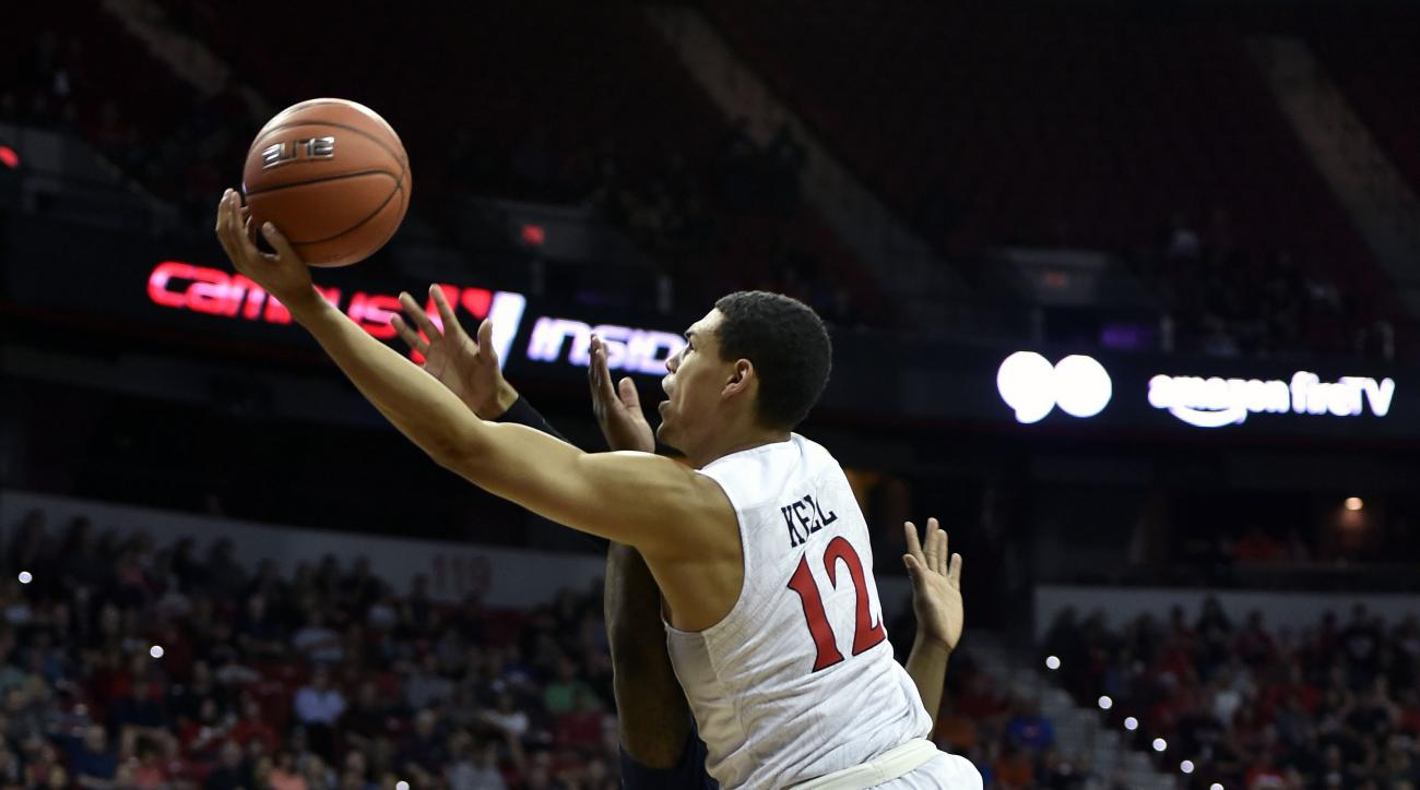 San Diego State's Trey Kell (12) shoots against Fresno State during the first half of an NCAA college basketball game in the finals of the Mountain West Conference men's tournament Saturday, March 12, 2016, in Las Vegas. (AP Photo/David Becker)