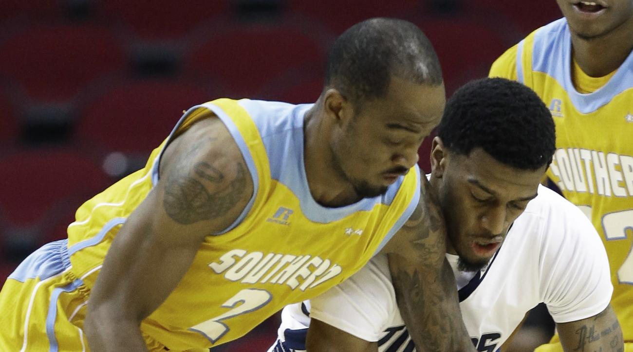 Southern's Adrian Rodgers (2) and Jackson State's Raeford Worsham chase a loose ball during the first half of an NCAA college basketball game in the final of the Southwestern Athletic Conference men's tournament Saturday, March 12, 2016, in Houston. (AP P