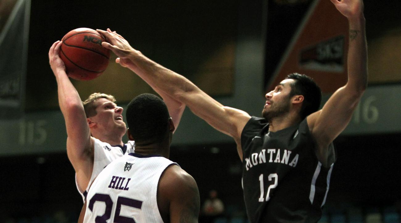 Weber State forward Dusty Baker (25) shoots in front of Montana forward Martin Breunig (12) in the first half of an NCAA college basketball game for the championship of the Big Sky conference men's tournament in Reno, Nev., Saturday, March 12, 2016. (AP P