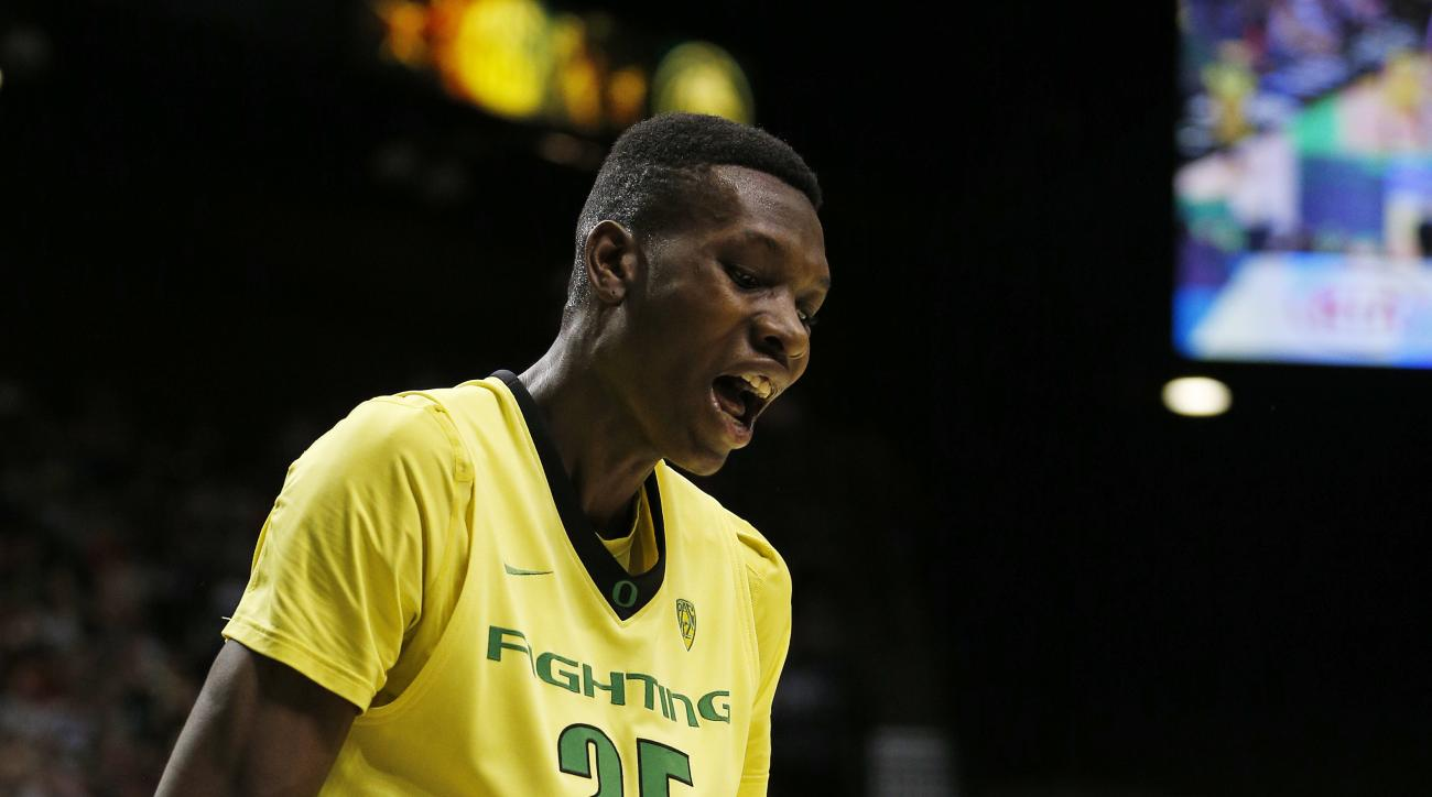 Oregon forward Chris Boucher reacts after a play against Utah during the first half of an NCAA college basketball game for the championship of the Pac-12 men's tournament Saturday, March 12, 2016, in Las Vegas. (AP Photo/John Locher)