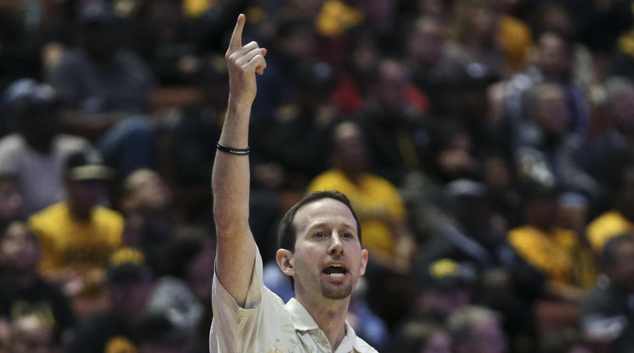 Hawaii coach Eran Ganot signals a play to his team during the first half of an NCAA college basketball championship game against Long Beach State at the Big West conference tournament Saturday March 12, 2016, in Anaheim, Calif. (AP Photo/Lenny Ignelzi)