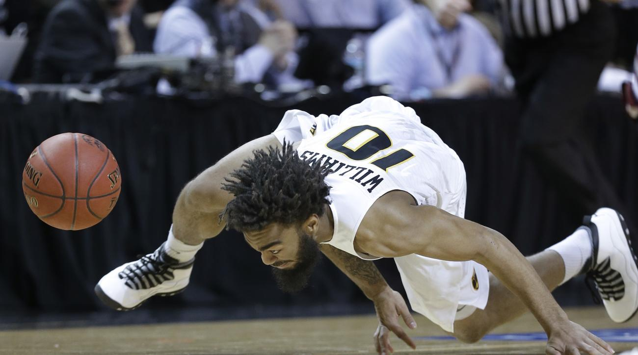 Virginia Commonwealth guard Jonathan Williams (10) stumbles as he chases after the ball in the first half of an NCAA college basketball game against Saint Joseph's during the championship game of the Atlantic 10 men's tournament, Sunday, March 13, 2016, i