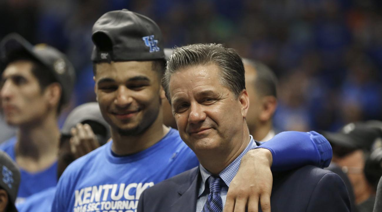 Kentucky head coach John Calipari, right, celebrates with Jamal Murray, left, after an NCAA college basketball game against Texas A&M in the championship of the Southeastern Conference tournament in Nashville, Tenn., Sunday, March 13, 2016. Kentucky won 8