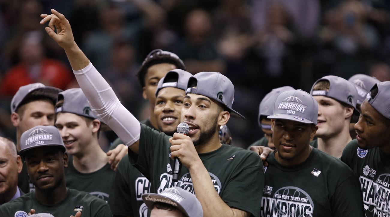 Michigan State's Denzel Valentine (45) thanks fans as he celebrates with his teammates after an NCAA college basketball game against Purdue in the finals at the Big Ten Conference tournament, Sunday, March 13, 2016, in Indianapolis. Michigan State won 66-