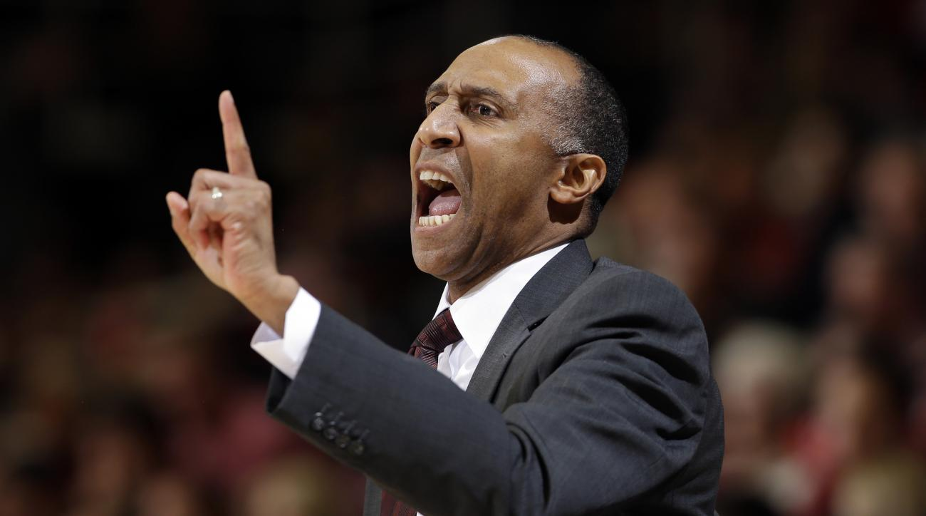 FILE - In this Jan. 14, 2016, file photo, Stanford head coach Johnny Dawkins talks to his players during the first half of an NCAA college basketball game against California in Stanford, Calif. Dawkins has been fired after eight seasons coaching the Stanf