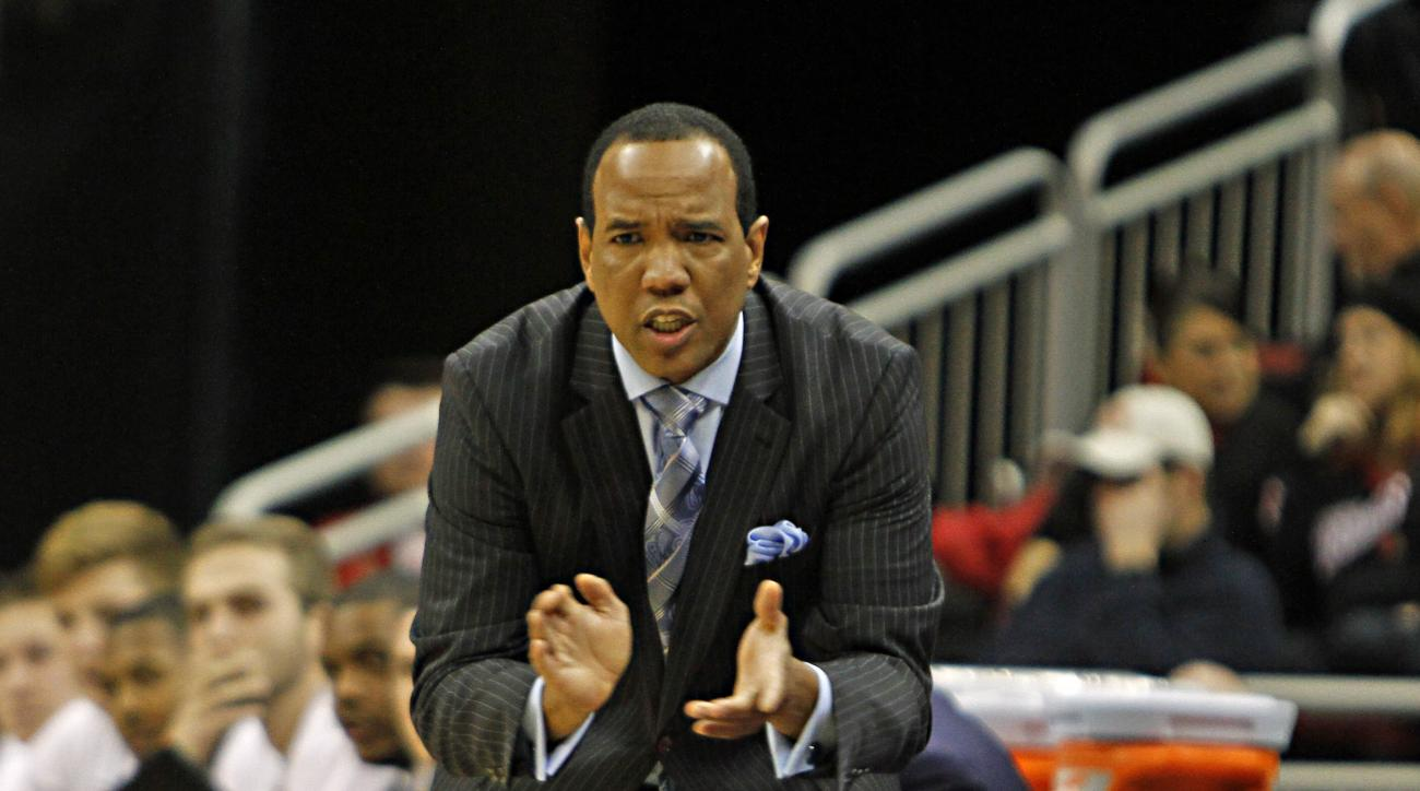 FILE - In this Dec. 14, 2014, file photo, North Carolina-Wilmington coach Kevin Keatts encourages his team against No. 5 Louisville in their NCAA college basketball game in Louisville, Ky. Former Louisville assistant Kevin Keatts is getting ready to take