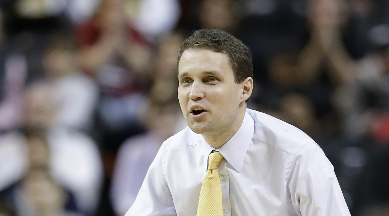 FILE - In this March 13, 2016, file photo, Virginia Commonwealth head coach Will Wade motions to players in the second half of an NCAA college basketball game against Saint Joseph's during the championship game of the Atlantic 10 men's tournament, in New