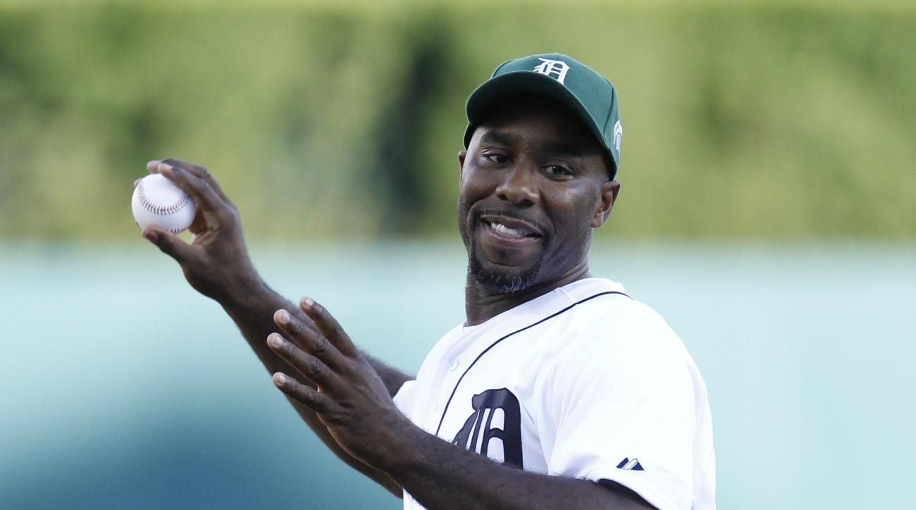 Mateen Cleaves, who led the Michigan State University basketball team to the 2000 National Championship, throws out a ceremonial first pitch before the Detroit Tigers baseball game against the Texas Rangers at Comerica Park Friday, Aug. 21, 2015, in Detro