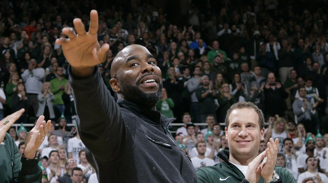 FILE - In this Dec. 21, 2015 file photo, former Michigan State player Mateen Cleaves, left, waves as he is introduced with Michigan State's 2000 national championship team during halftime of Michigan State-Florida NCAA college basketball game in East Lans