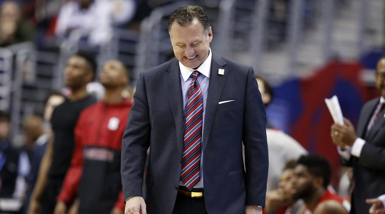 FILE - In this March 8, 2016, file photo, North Carolina State head coach Mark Gottfried reacts during the second half of an NCAA college basketball game against Wake Forest in the Atlantic Coast Conference tournament in Washington. Gottfried led the Wolf