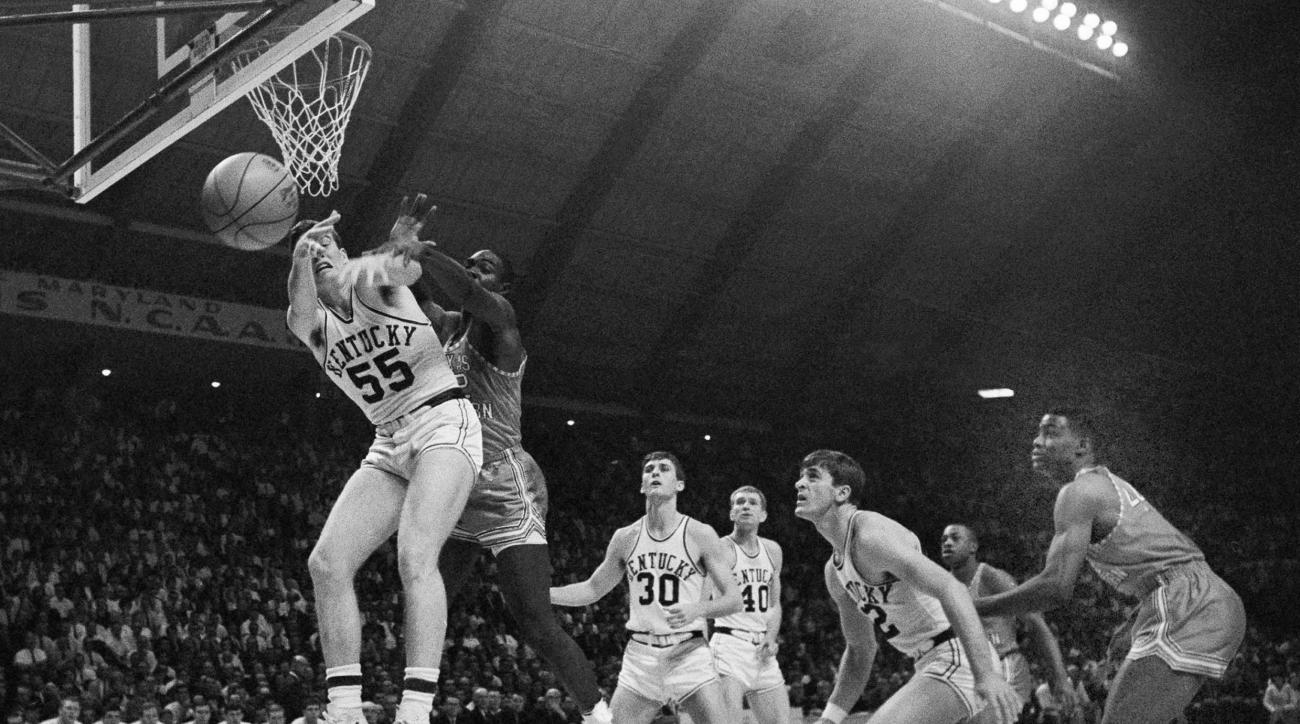 FILE - In this March 19, 1966, file photo, Kentucky's Thad Jaracz (55) and Texas Western's David Latin (42) reach for a rebound during the first period of the NCAA men's baksetball championship game in College Park, Md. Other Kentucky players shown are To
