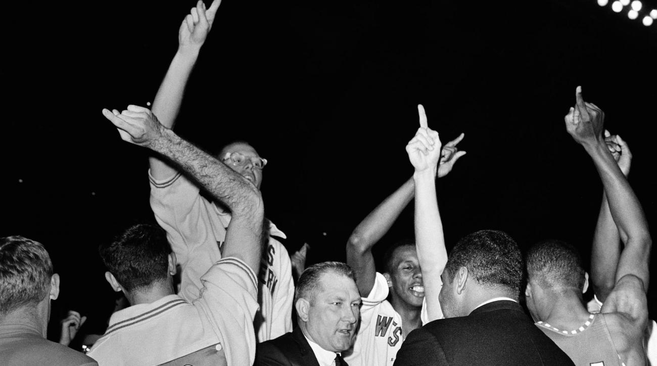 FILE - In this March 20, 1966 file photo, Texas Western coach Don Haskins, center, is congratulated after Texas Western defeated Kentucky 72-65 to win the NCAA men's college basketball championship in College Park, Md. Fifty years ago, Texas Western start