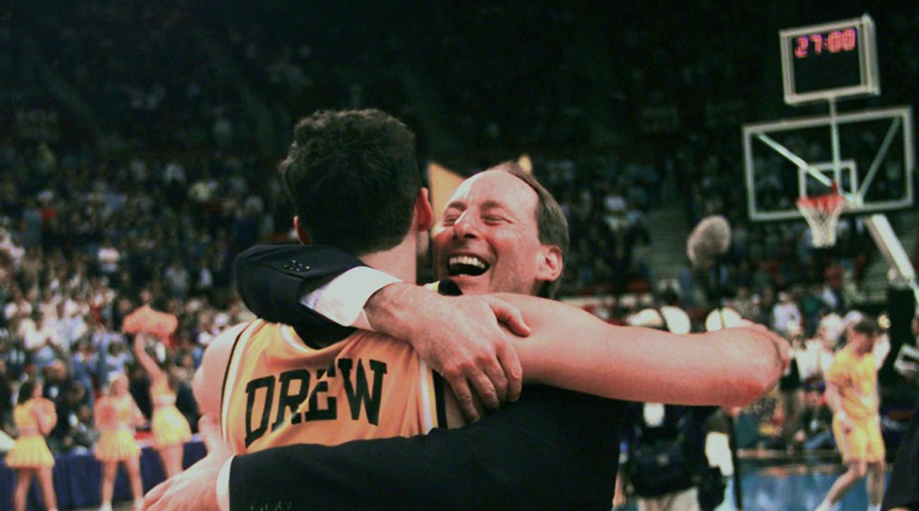 FILE - In this March 13, 1998, file photo, Valparaiso's head coach Homer Drew hugs his son, Bryce Drew, after Bryce hit a game-winning three-point shot at the buzzer to beat Mississippi 70-69 in the first round of the NCAA Midwest Regional college basketb