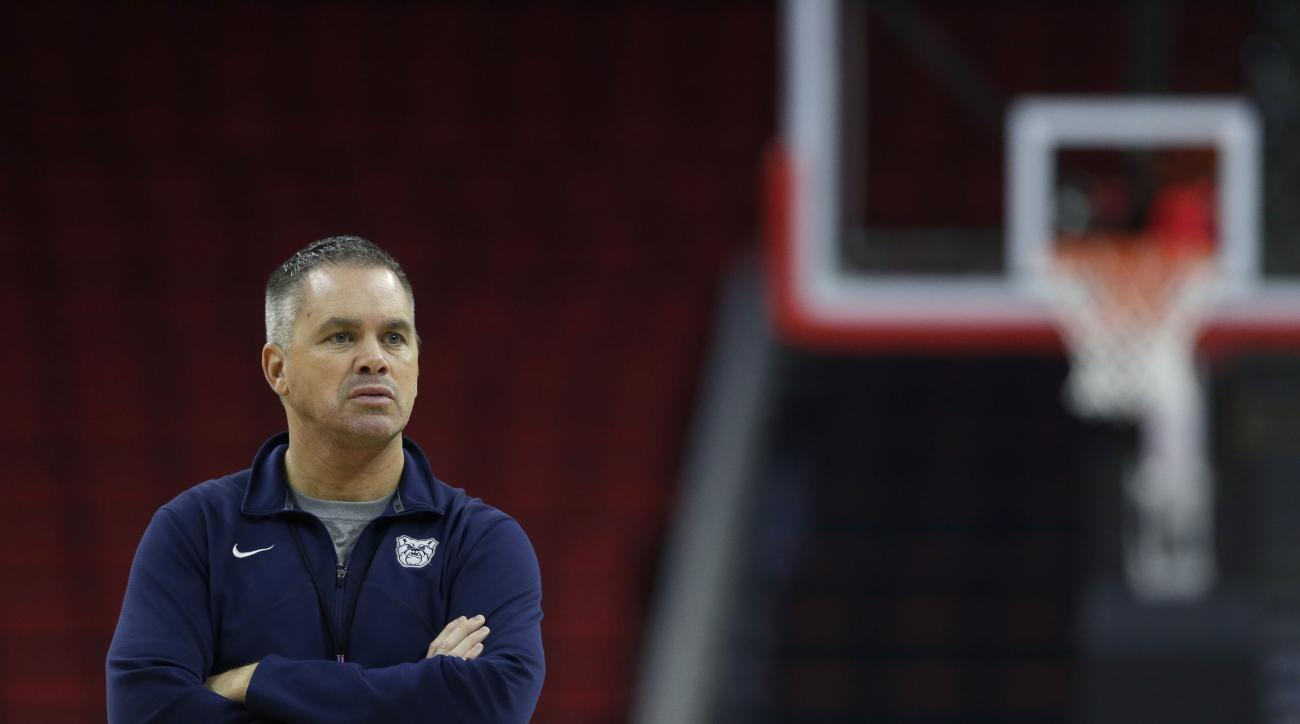 Butler coach Chris Holtmann watches during practice for a first-round men's college basketball game in the NCAA  Tournament  Raleigh, N.C., Wednesday, March 16, 2016. Butler plays Texas Tech on Thursday. (AP Photo/Gerry Broome)