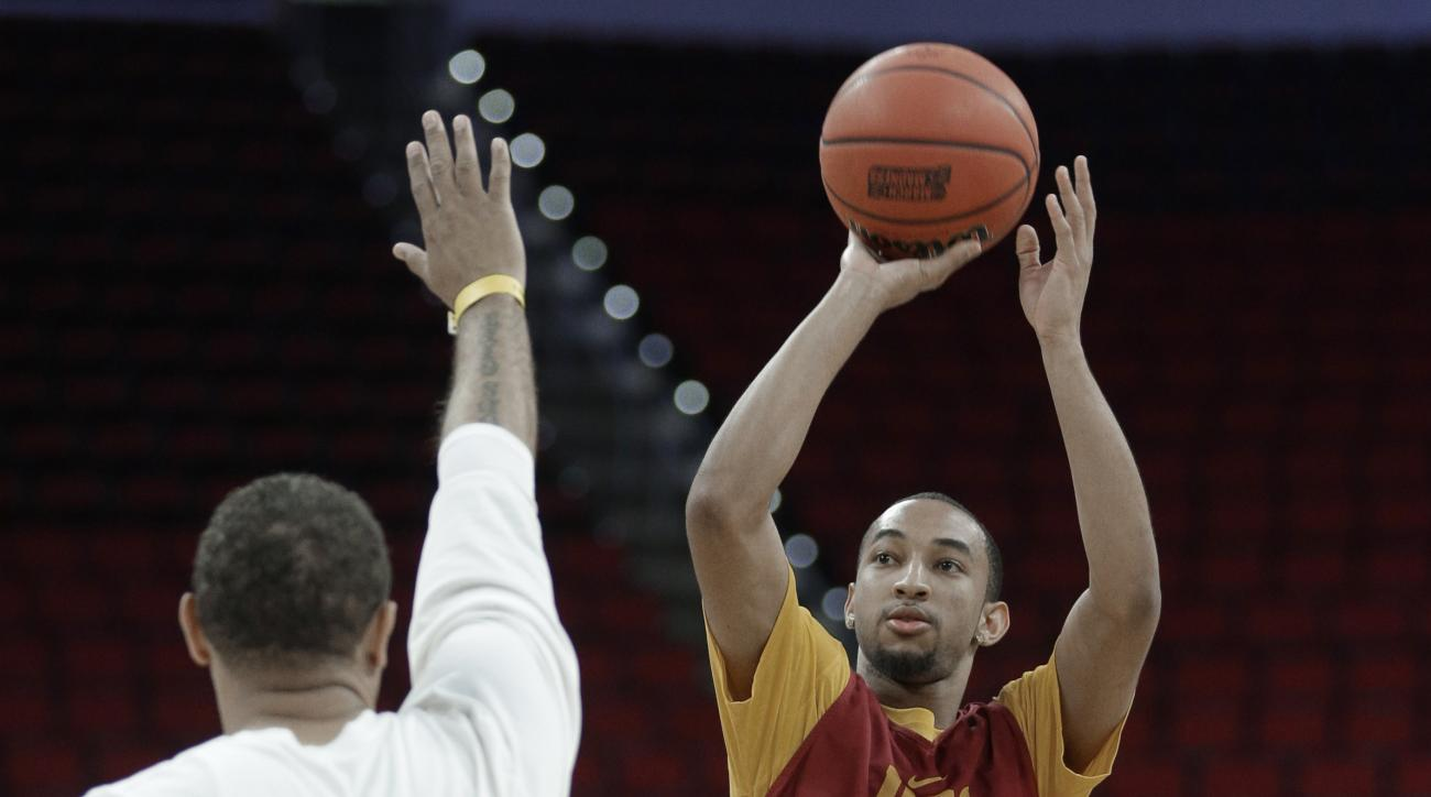 Southern California's Jordan McLaughlin shoots over an assistant coach during practice for a first-round men's college basketball game in the NCAA Tournament in Raleigh, N.C., Wednesday, March 16, 2016. Southern California plays Providence on Thursday. (A
