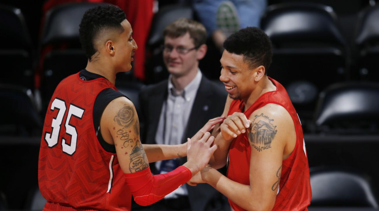 Utah forward Kyle Kuzma, left, jokes with forward Jordan Loveridge during practice for a first-round men's college basketball game Wednesday, March 16, 2016, in the NCAA Tournament in Denver. Utah faces Fresno State on Thursday. (AP Photo/David Zalubowski