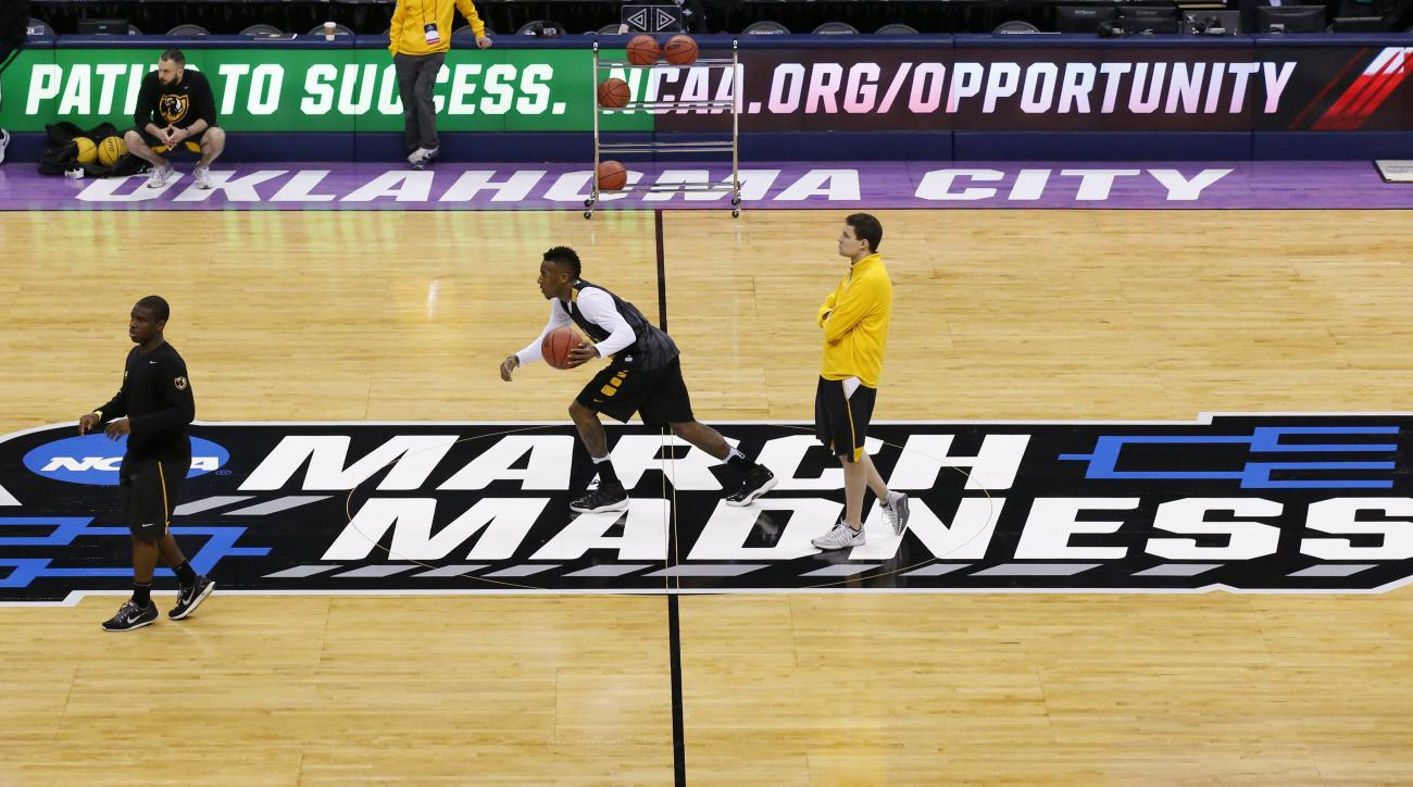 Virginia Commonwealth guard Melvin Johnson, center, dribbles across the court as head coach Will Wade, right, watches, during a practice for a first round men's college basketball game in the NCAA Tournament, Thursday, March 17, 2016, in Oklahoma City, Ok