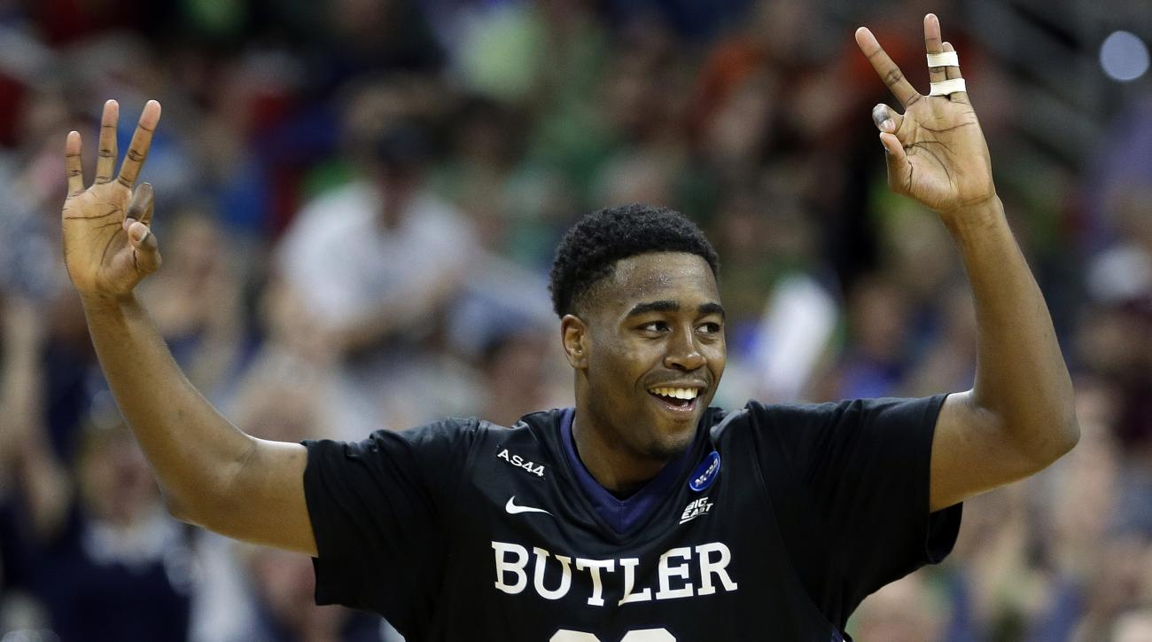 Butler forward Kelan Martin (30) celebrates his three-point shot against Texas Tech during the second half of a first-round men's college basketball game in the NCAA Tournament, Thursday, March 17, 2016, in Raleigh, N.C. (AP Photo/Gerry Broome)