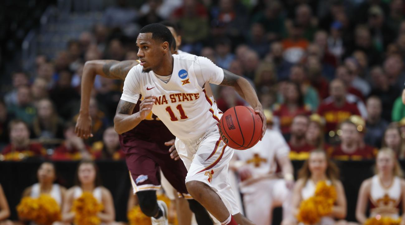 Iowa State guard Monte Morris picks up a loose ball against Iona in the first half of a first-round men's college basketball game Thursday, March 17, 2016, in the NCAA Tournament in Denver. (AP Photo/David Zalubowski)