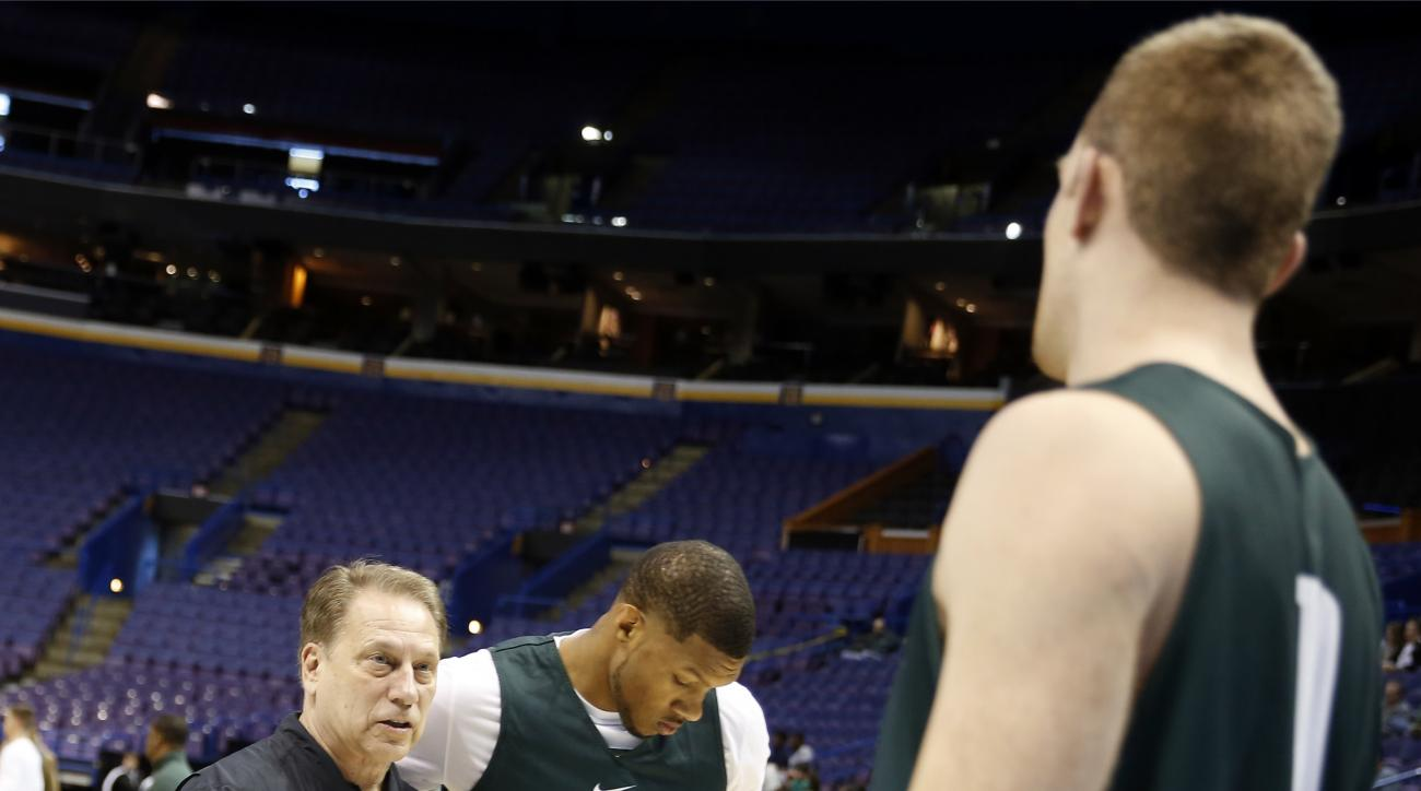 Michigan State head coach Tom Izzo, left, talks with Matt Costello, right, as Marvin Clark Jr. (15) walks past during practice ahead of a first-round men's college basketball game in the NCAA Tournament, Thursday, March 17, 2016, in St. Louis. Michigan St