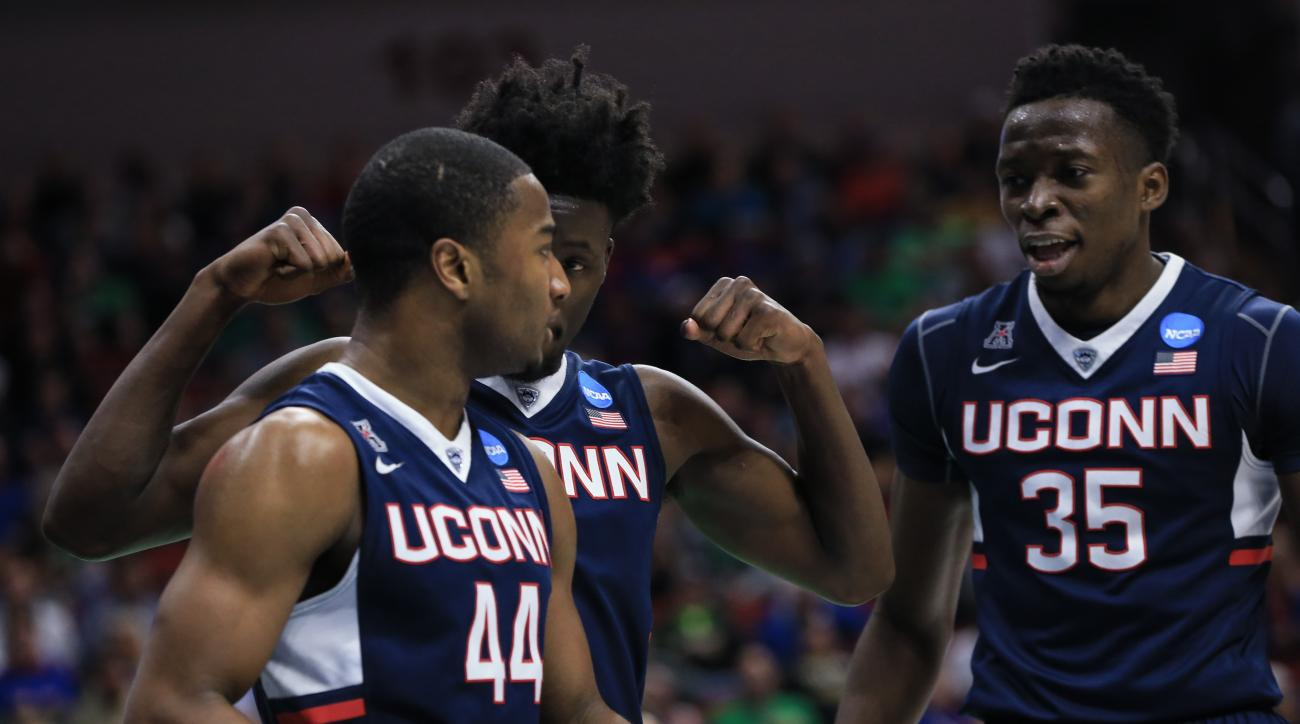 Connecticut's Rodney Purvis (44), Amida Brimah (35) and Daniel Hamilton, center, celebrate after a foul called against Colorado, during a first-round men's college basketball game in the NCAA Tournament in Des Moines, Iowa, Thursday, March 17, 2016. Conne