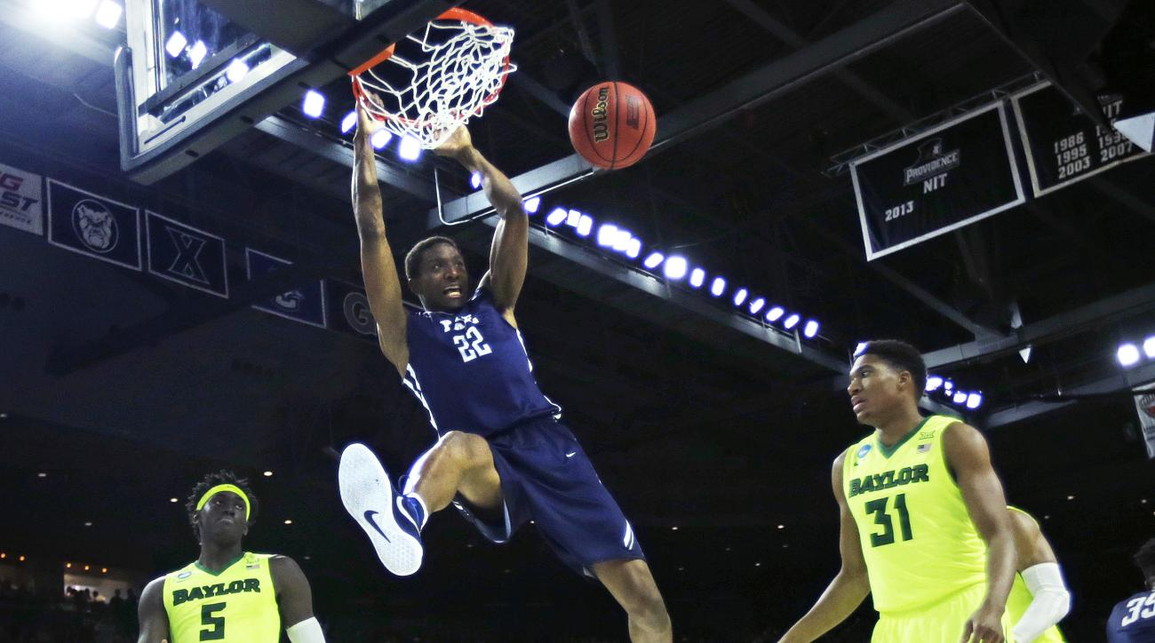Yale forward Justin Sears (22)  dunks against Baylor during the first half in the first round of the NCAA college men's basketball tournament in Providence, R.I., Thursday, March 17, 2016. (AP Photo/Charles Krupa)