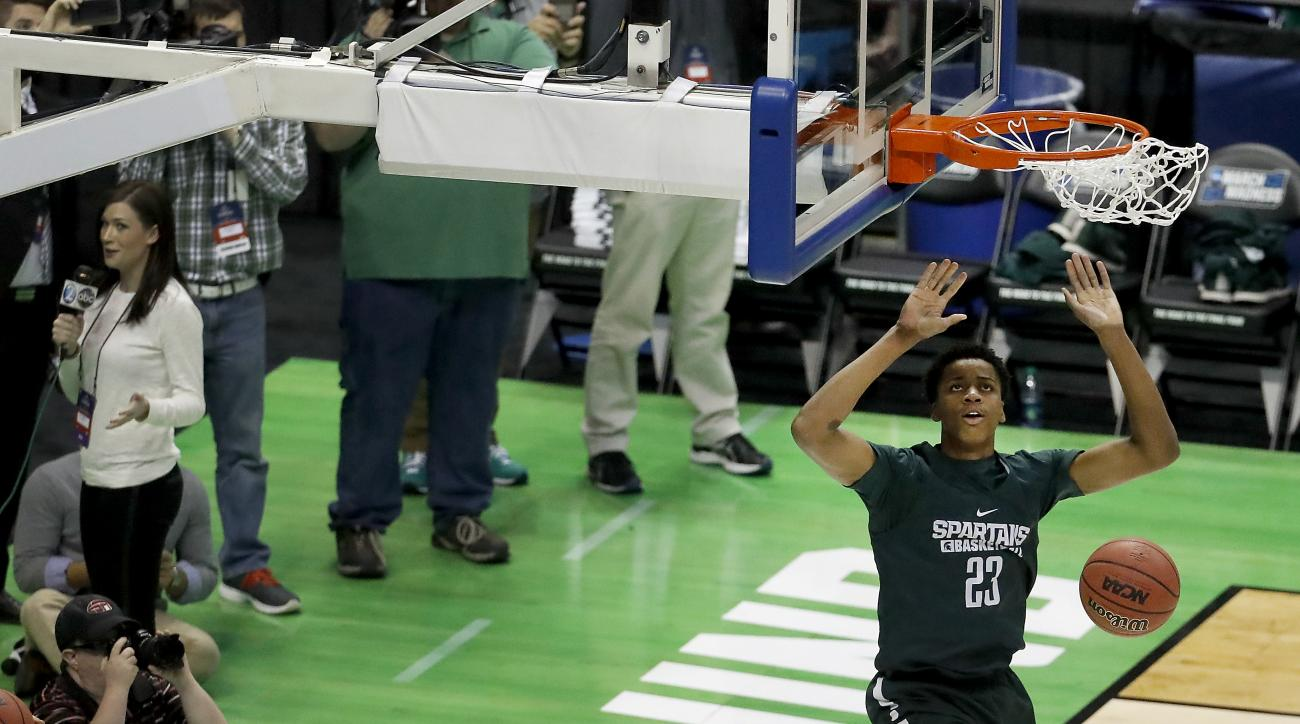 Michigan State's Deyonta Davis dunks the ball during practice ahead of a first-round men's college basketball game in the NCAA Tournament, Thursday, March 17, 2016, in St. Louis. Michigan State plays Middle Tennessee on Friday. (AP Photo/Charlie Riedel)