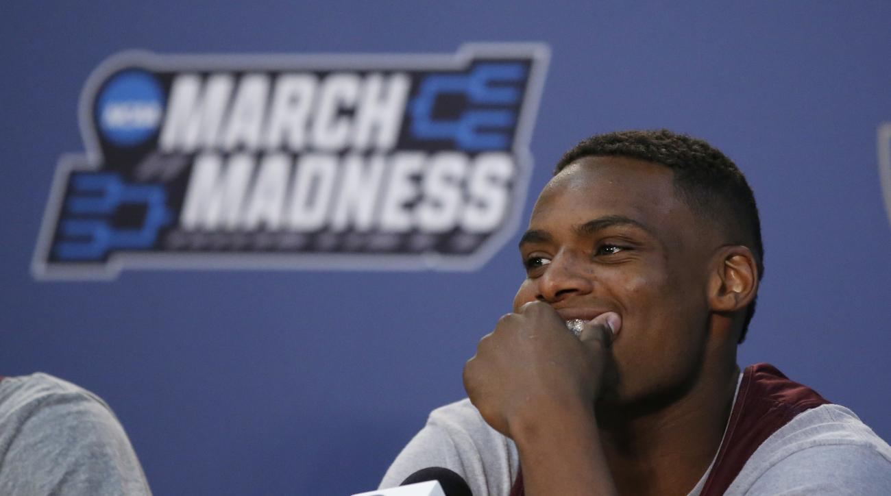 Texas A&M guard Danuel House smiles during a news conference on a practice day for a first-round men's college basketball game in the NCAA Tournament, Thursday, March 17, 2016, in Oklahoma City. (AP Photo/Sue Ogrocki)