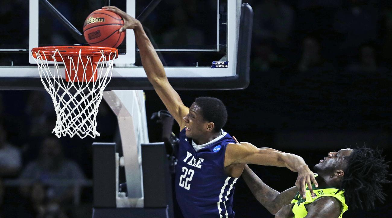 Yale forward Justin Sears (22) slams a dunk as he gets past Baylor forward Taurean Prince (21) in the second half during the first round of the NCAA college men's basketball tournament in Providence, R.I., Thursday, March 17, 2016. (AP Photo/Charles Krupa