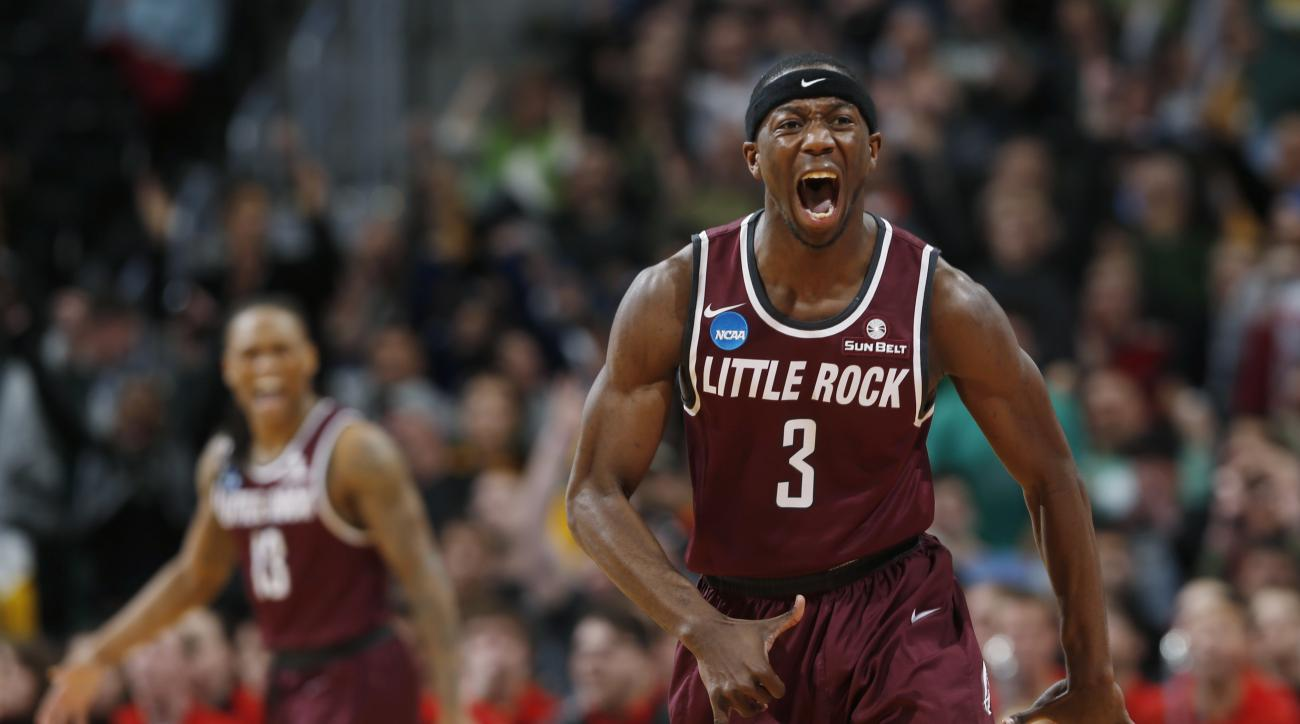 Arkansas Little Rock guard Josh Hagins reacts after hitting three-point basket against Purdue in the second half of a first-round men's college basketball game Thursday, March 17, 2016, in the NCAA Tournament in Denver. Arkansas Little Rock won 85-83 in d