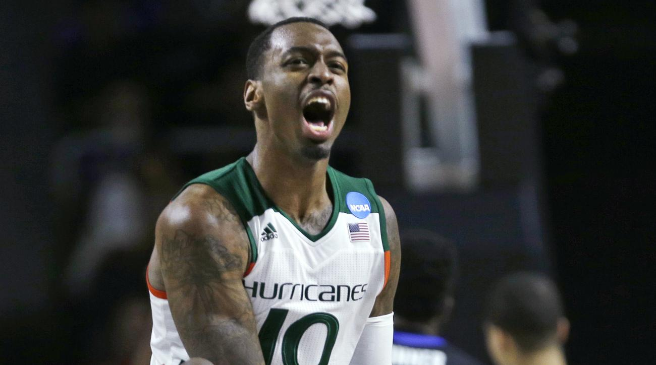Miami guard Sheldon McClellan (10) reacts to a basket by teammate Kamari Murphy, who also drew a foul on the play, during the second half against Buffalo during the first round of the NCAA college men's basketball tournament in Providence, R.I., Thursday,