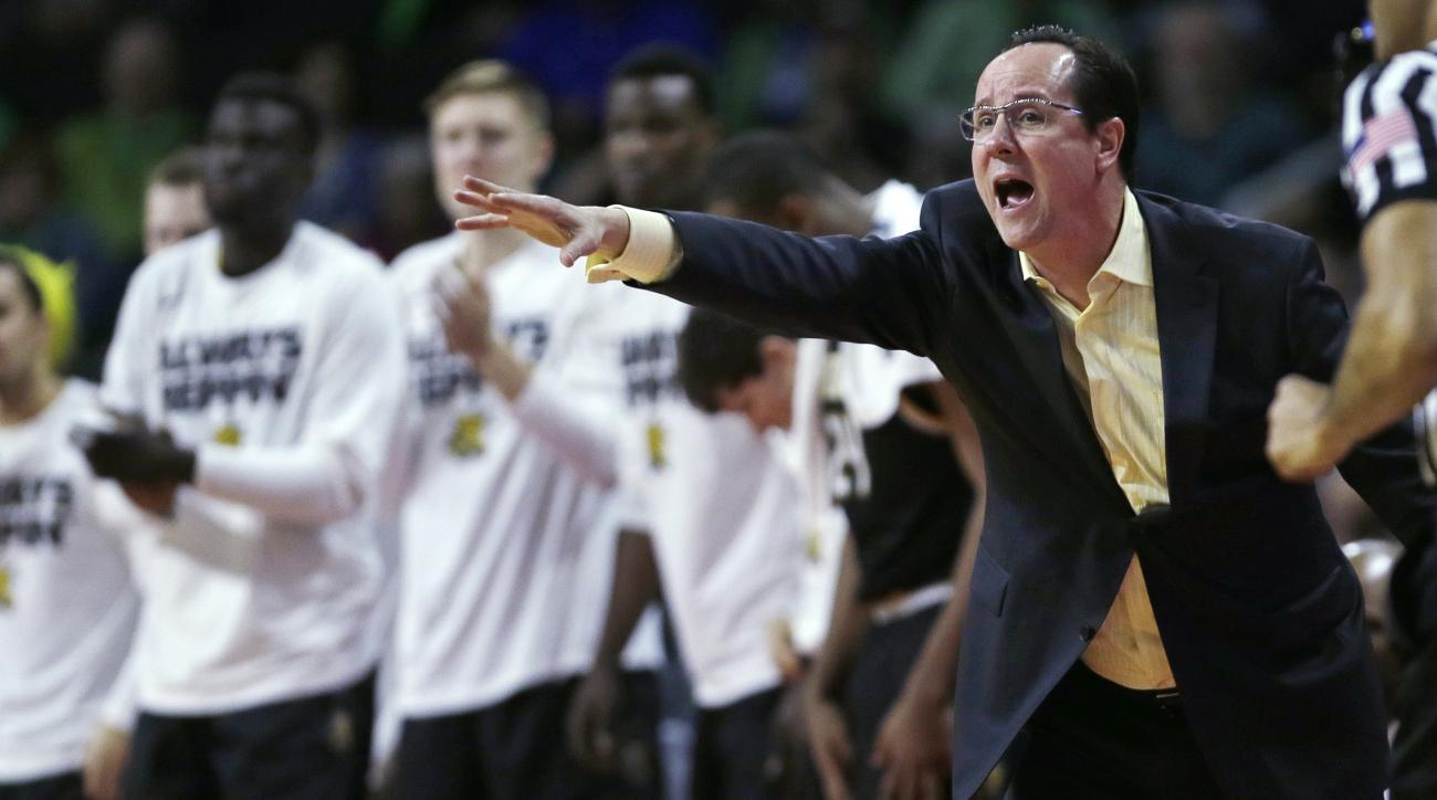 Wichita State coach Gregg Marshall calls to his players during the first half of an NCAA college basketball game against Arizona in the NCAA tournament in Providence, R.I., Thursday, March 17, 2016.  (AP Photo/Charles Krupa)