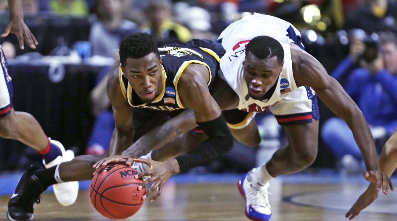 Wichita State forward Markis McDuffie, left, and Arizona guard Kadeem Allen, right, vie for a loose ball during the first half of a first-round game of the NCAA men's college basketball tournament in Providence, R.I., Thursday, March 17, 2016. (AP Photo/C