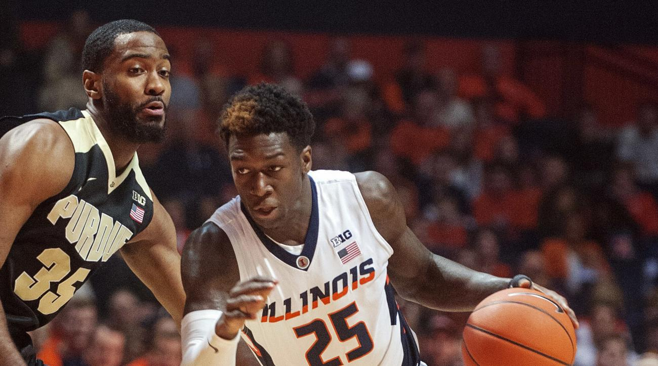 FILE - In this Jan. 10, 2016, file photo, Illinois junior guard Kendrick Nunn (25) drives to the basket during an NCAA College basketball game against Purdue in Champaign, Ill. Nunn is expected to make his first court appearance Friday, March 18, 2016, in