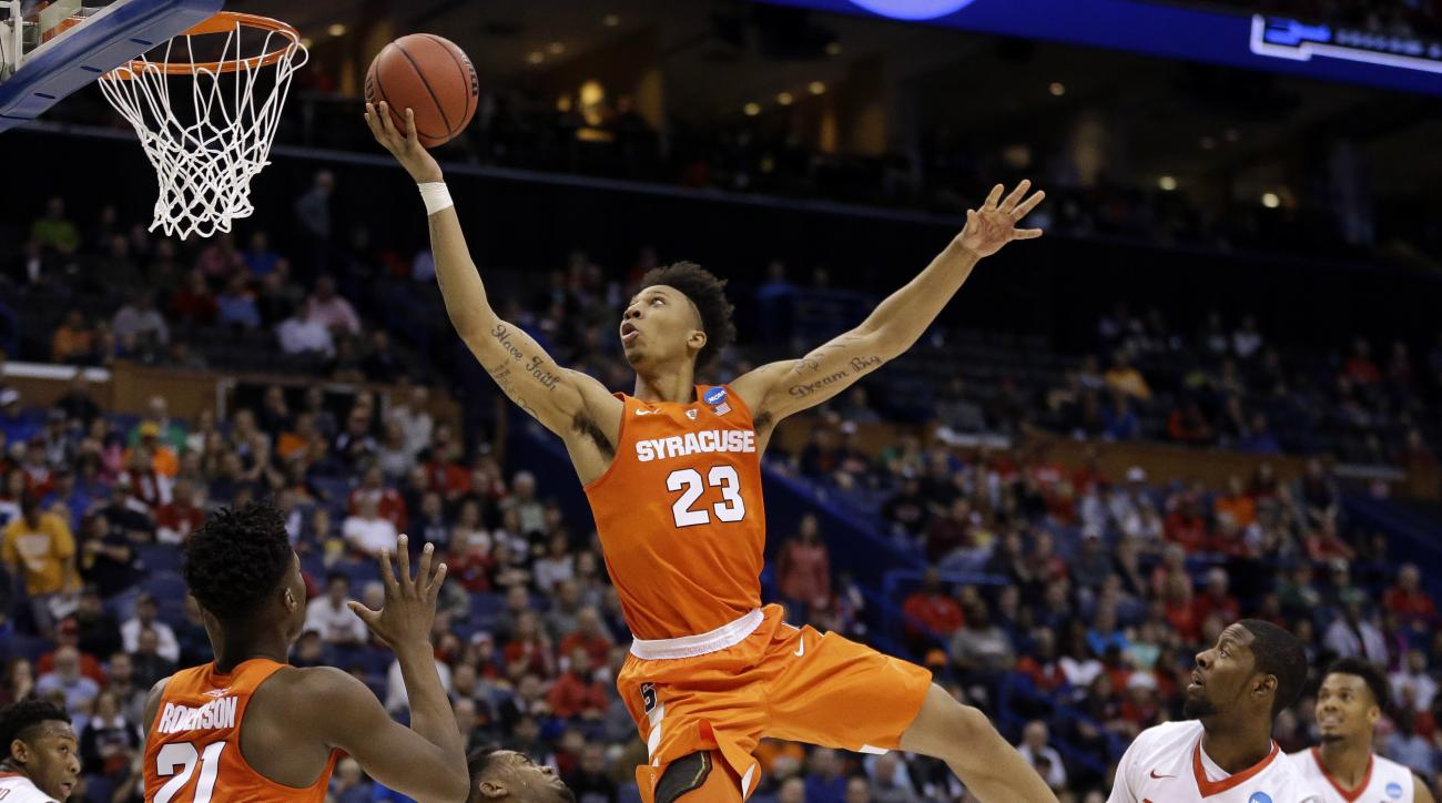Syracuse's Malachi Richardson (23) is fouled on his way to the basket by Dayton's Dyshawn Pierre as Syracuse's Tyler Roberson (21) and Dayton's Scoochie Smith (11) watch during the second half in a first-round men's college basketball game in the NCAA tou