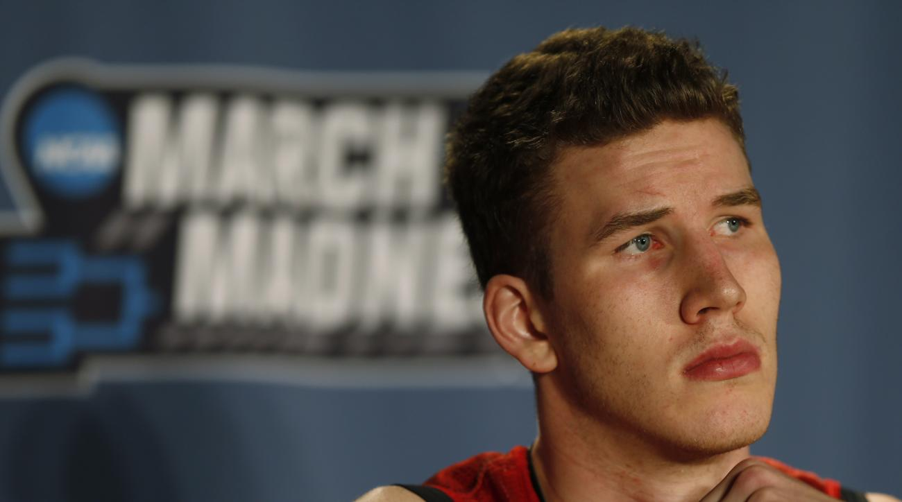 Utah center Jakob Poeltl considers a question during a news conference as the team prepares for a second-round men's college basketball game Friday, March 18, 2016, in the NCAA Tournament in Denver. Utah will face Gonzaga on Saturday. (AP Photo/David Zalu