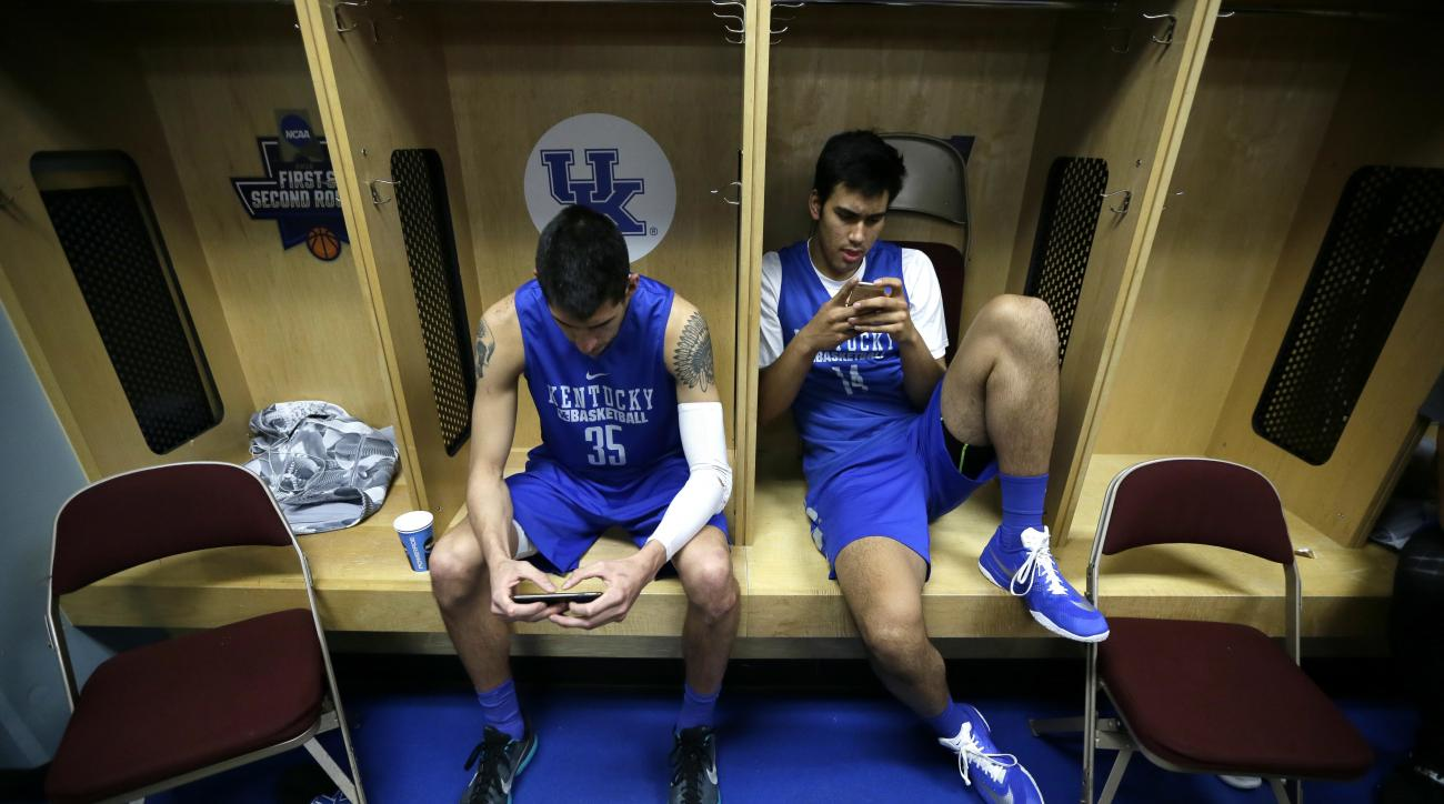 Kentucky's Derek Willis, left, and Tai Wynyard sit in the locker room before practice ahead of a second-round men's college basketball game in the NCAA Tournament, Friday, March 18, 2016, in Des Moines, Iowa. Kentucky will play Indiana on Saturday. (AP Ph