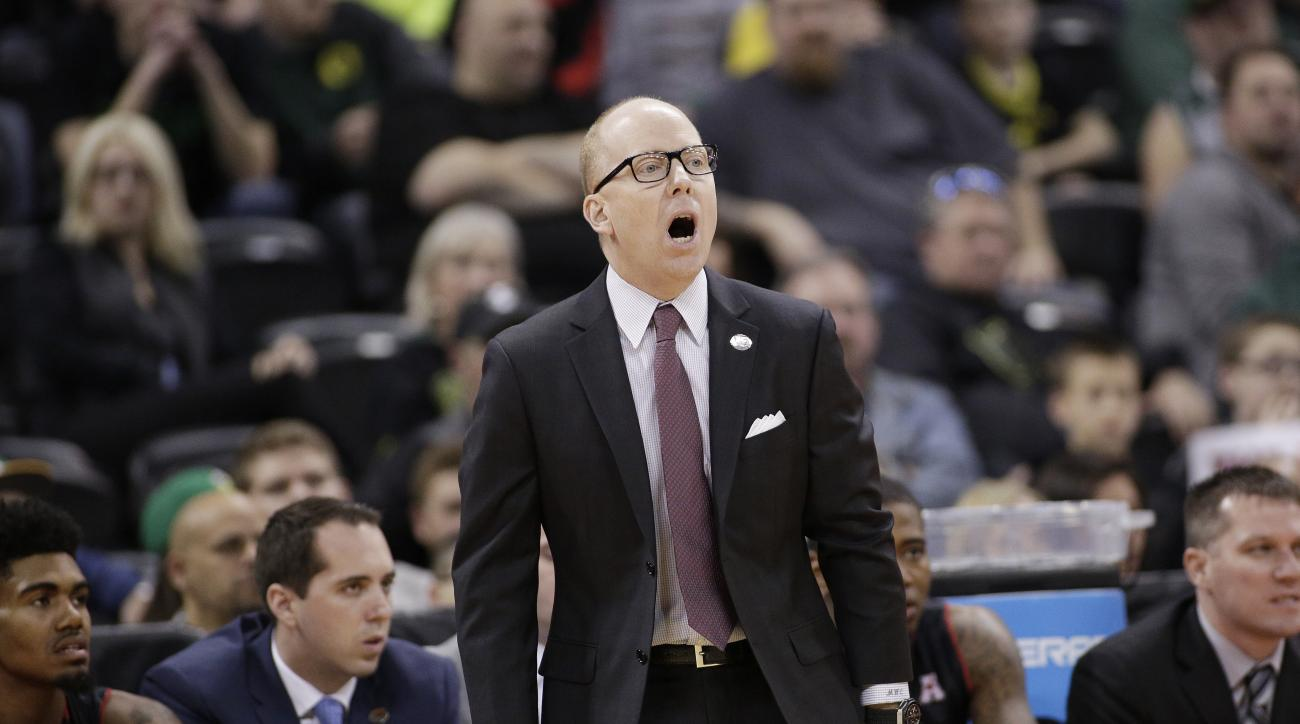 Cincinnati head coach Mick Cronin instruct his team during the first half of a first-round men's college basketball game against Saint Joseph's in the NCAA Tournament in Spokane, Wash., Friday, March 18, 2016. (AP Photo/Young Kwak)