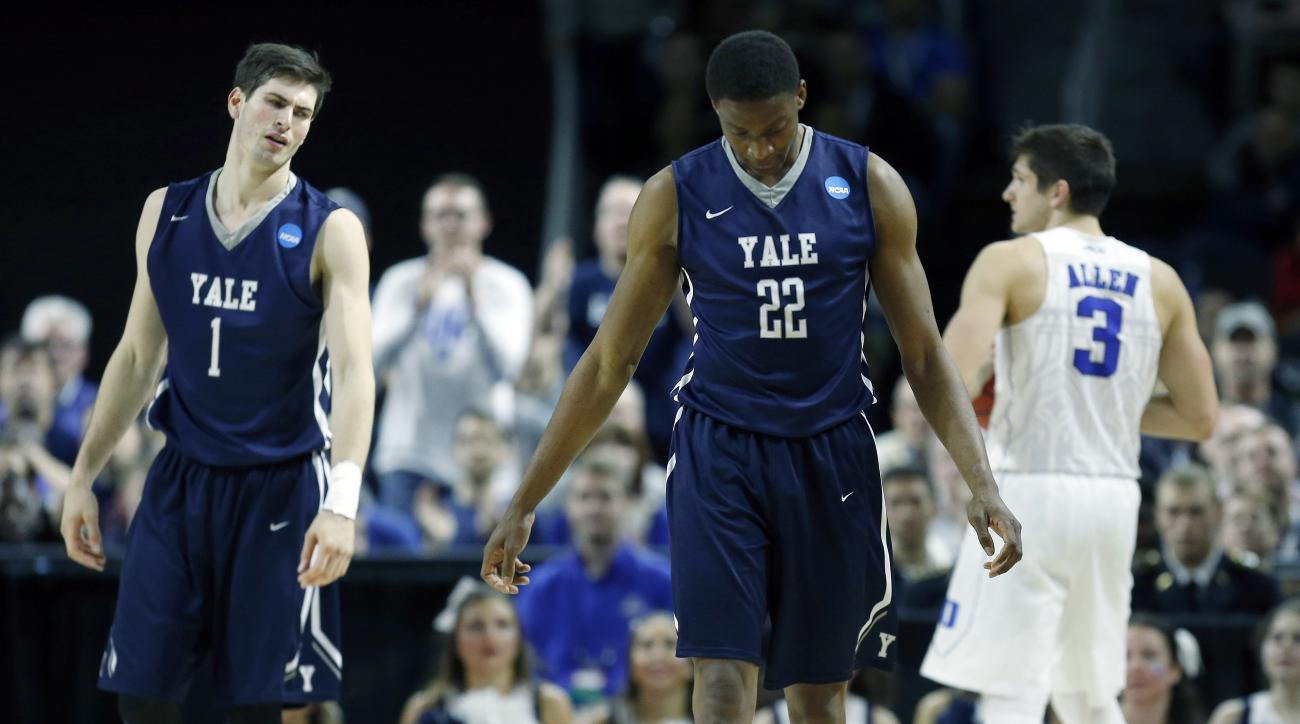 Yale's Justin Sears (22) and Anthony Dallier (1) react in front of Duke's Grayson Allen (3) after a turnover during the second half in the second round of the NCAA men's college basketball tournament in Providence, R.I., Saturday, March 19, 2016. Duke won