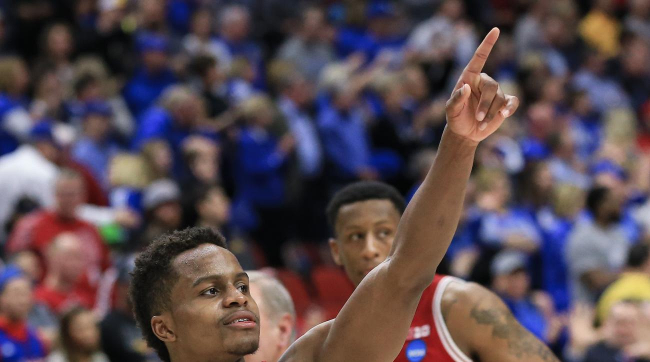 Indiana's Kevin Yogi Ferrell (11) gestures to fans following a second-round men's college basketball game against Kentucky in the NCAA Tournament in Des Moines, Iowa, Saturday, March 19, 2016. Indiana won 73-67. (AP Photo/Nati Harnik)