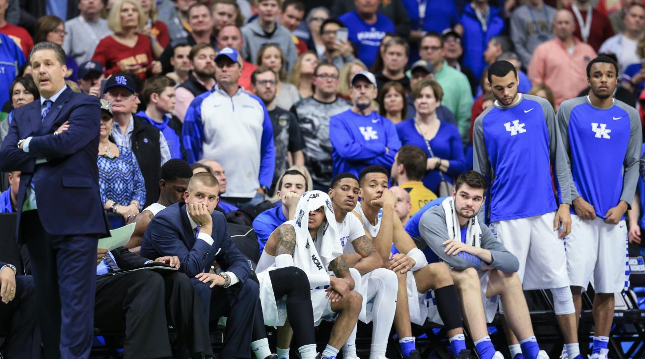 The Kentucky bench and coach John Calipari, left, follow the final seconds of a second-round men's college basketball game against Indiana in the NCAA Tournament in Des Moines, Iowa, Saturday, March 19, 2016. Indiana won 73-67. (AP Photo/Nati Harnik)
