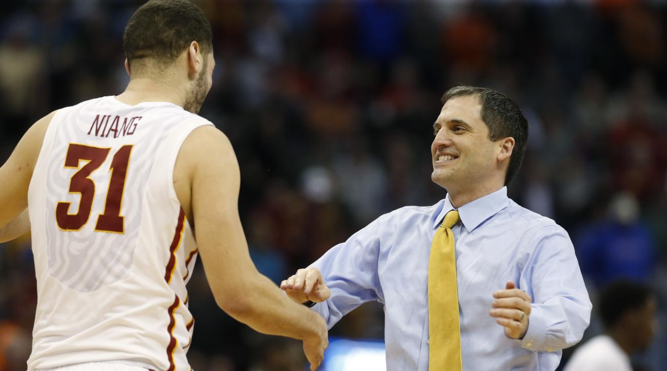 Iowa State forward Georges Niang, left, goes to hug head coach Steve Prohm after the second half of a second-round men's college basketball game against Arkansas Little Rock Saturday, March 19, 2016, in the NCAA Tournament in Denver. Iowa State won 78-61.