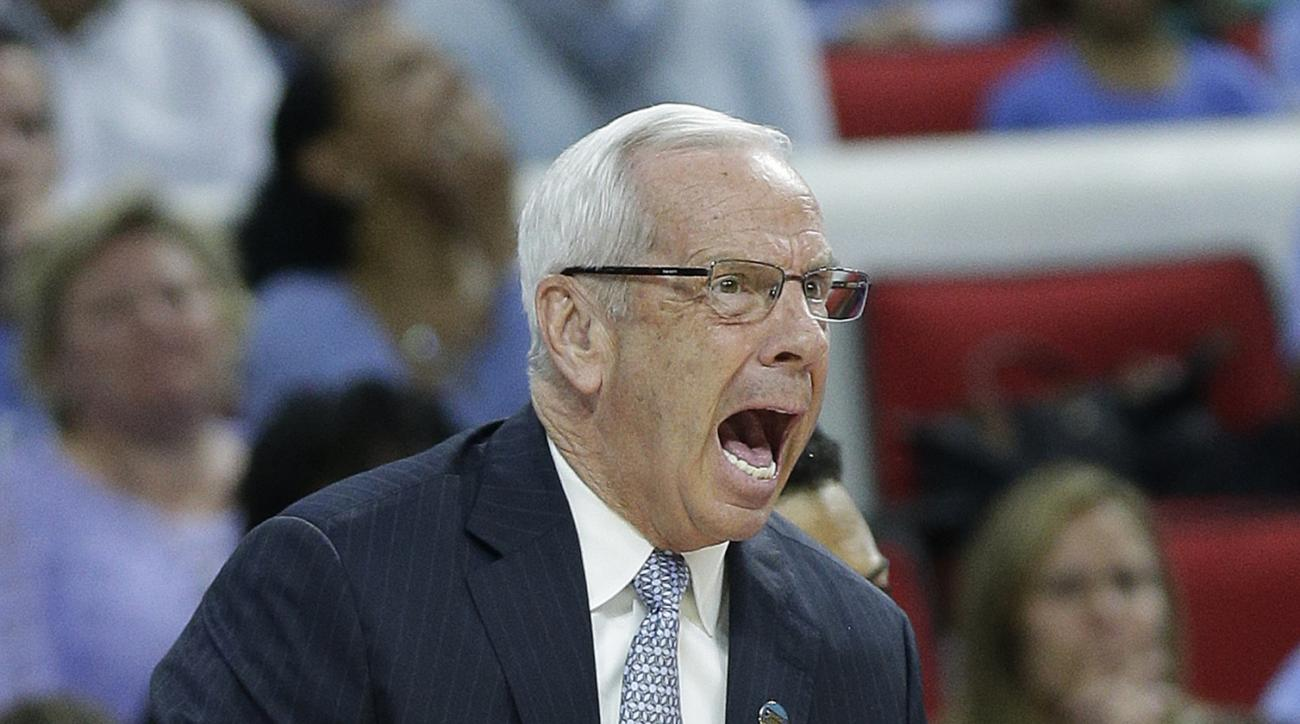 North Carolina head coach Roy Williams speaks to players during the first half of a second-round men's college basketball game in the NCAA Tournament against Providence, Saturday, March 19, 2016, in Raleigh, N.C. (AP Photo/Chuck Burton)
